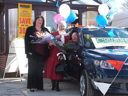 Cousins Conservatories Car Giveaway Jackie handing over the keys to the luck winners