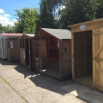 Cousins Conservatories and Garden Buildings Showing a Selection of Sheds Playhouses
