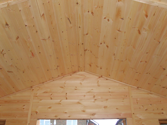Lining of ceiling and front wall above door