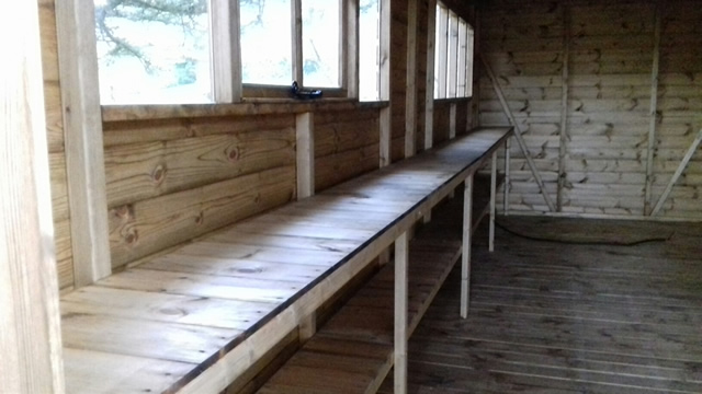 wooden-workshop-with-double-height-workbench