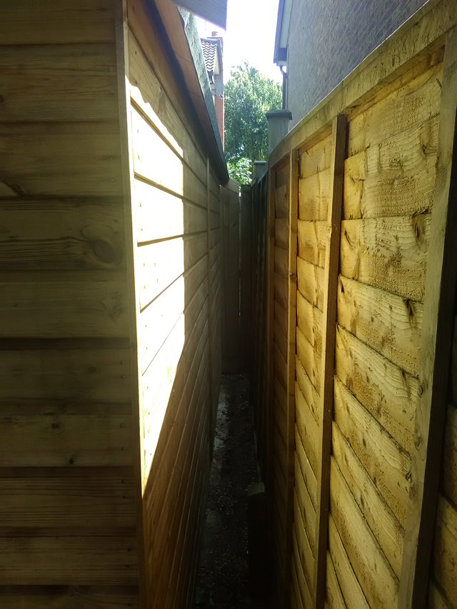 Royston Apex 12x5 Fitted Close to Fence