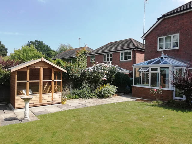 Picture showing conservatory and summerhouse together