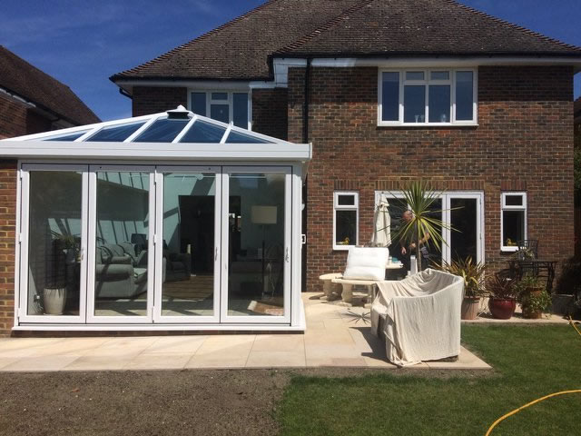 Conservatory Installation with Bi-Folding Doors in West Sussex - Beckwith