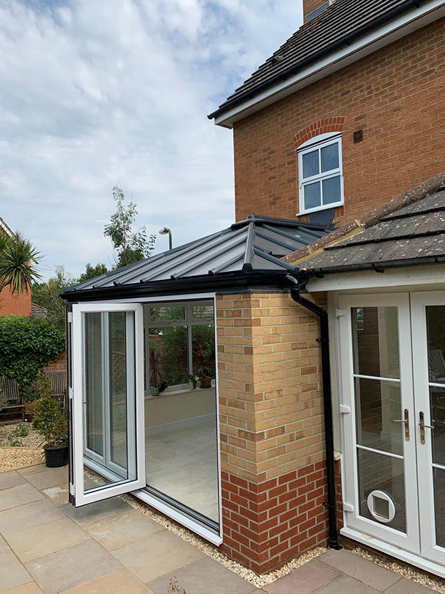 Living Roof Conservatory Extension with Sliding Doors in Southwater - West