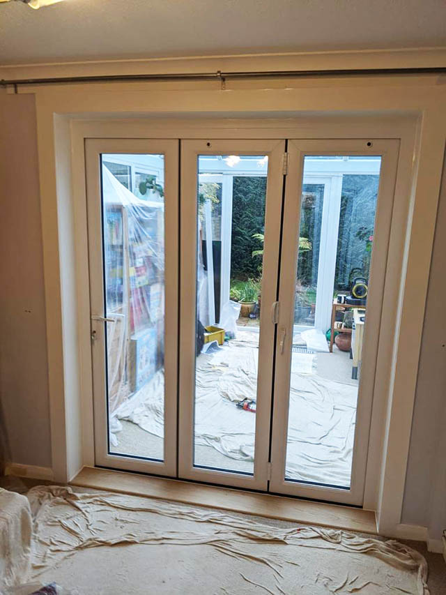 Internal Pictures of Triple Bifold Doors in White UPVc Installed in Horsham West Sussex - Webb