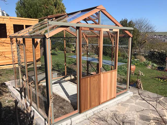 Alton Eight Greenhouse Installed on to Custom Made Concrete Base - Gardiner