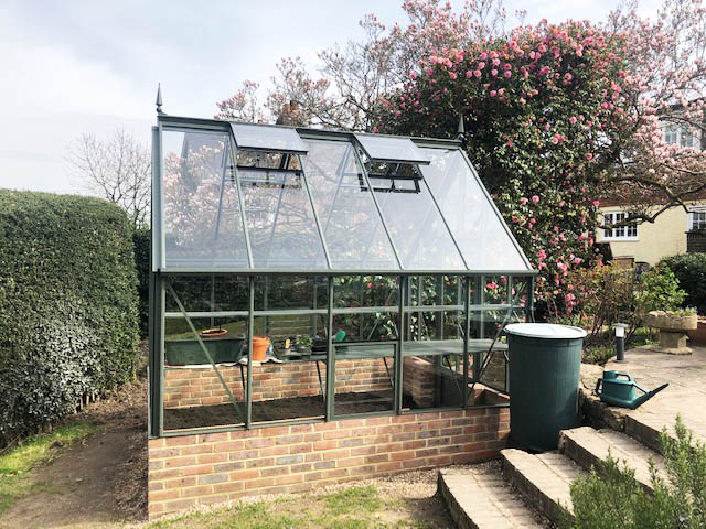 Side View of a Robinsons Victorian Greenhouse Installation in Forest Row - Emslie