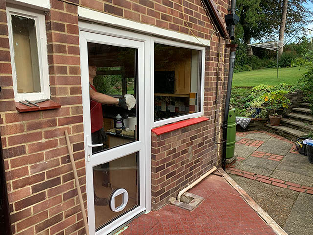 Installation of a New PVCu Back Door and Side Window in Henfield - Canning